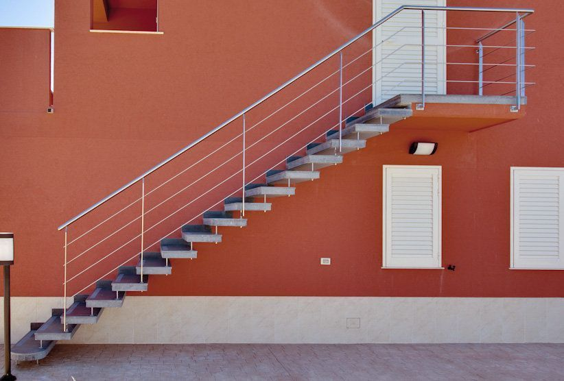 prefabricated cantilevered stairs of flamed lava stone