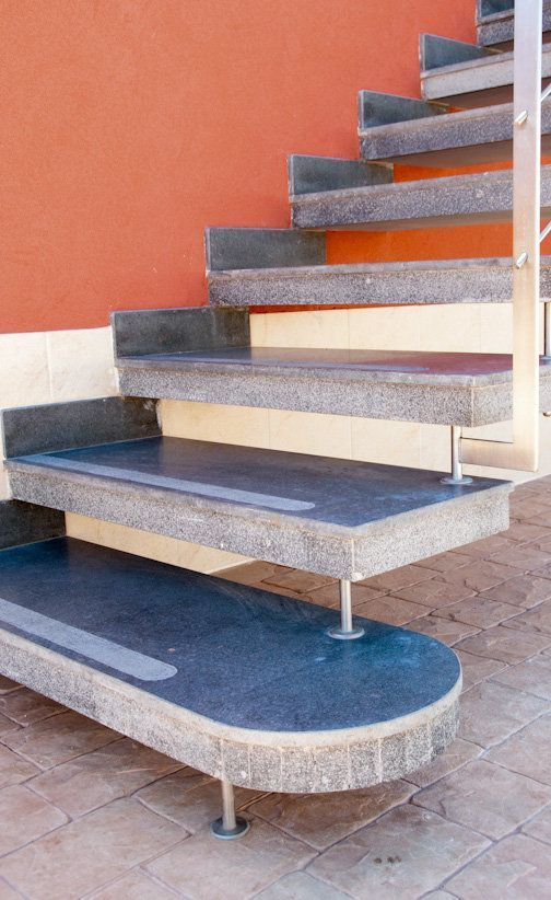 Prefabricated cantilevered stairs of flamed lava stone for Fargione scale