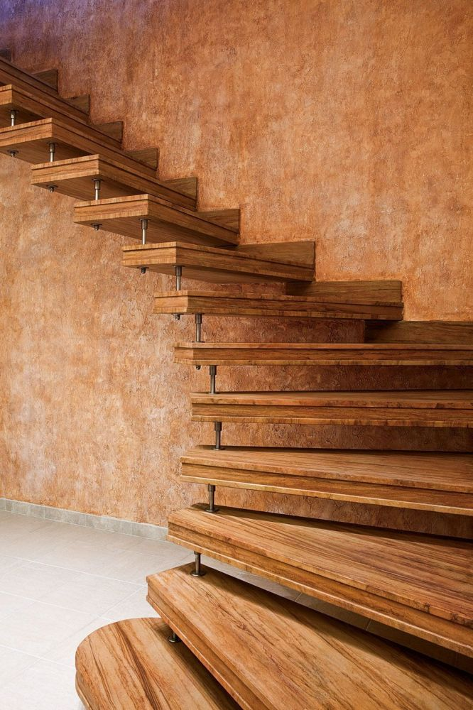 Prefabricated elliptical stairs of veined rainbow stone for Fargione scale